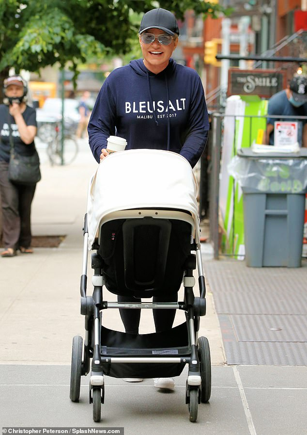 Happy grandma: Yolanda Hadid was all smiles while pushing granddaughter Khai around New York on Wednesday