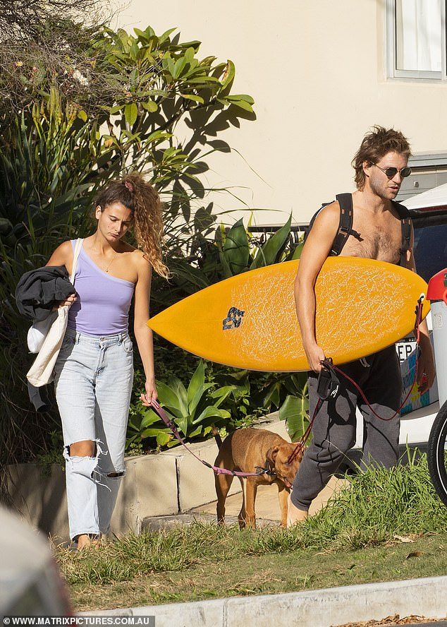 Stunner:Meanwhile, French model Manon stunned in stone-washed blue boyfriend jeans, and one-shoulder lilac tank