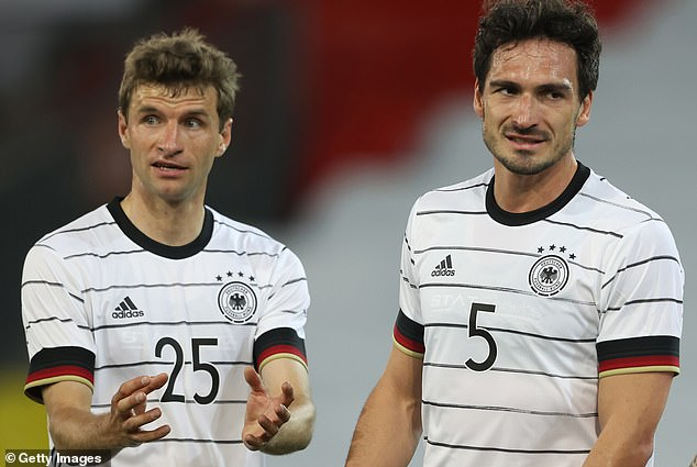 Mats Hummels (right) and Thomas Muller both made their returns for Germany for the first time in over two years during Wednesday night's 1-1 friendly draw with Denmark