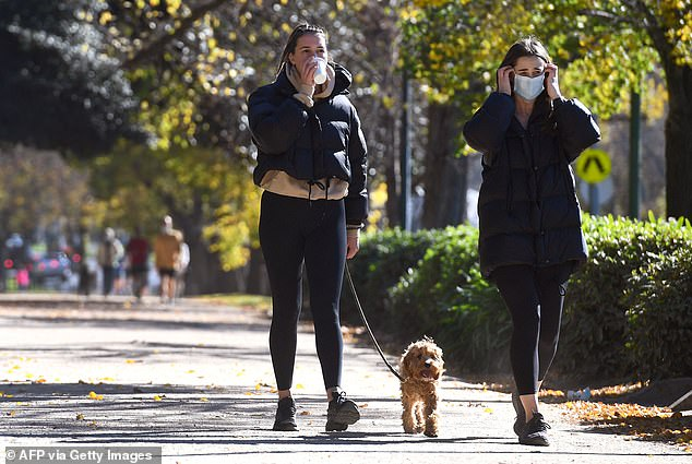 The alert comes as authorities announced Melbourne's lockdown will be extended until June 10. Pictured: Two woman are seen exercising in Melbourne on Wednesday