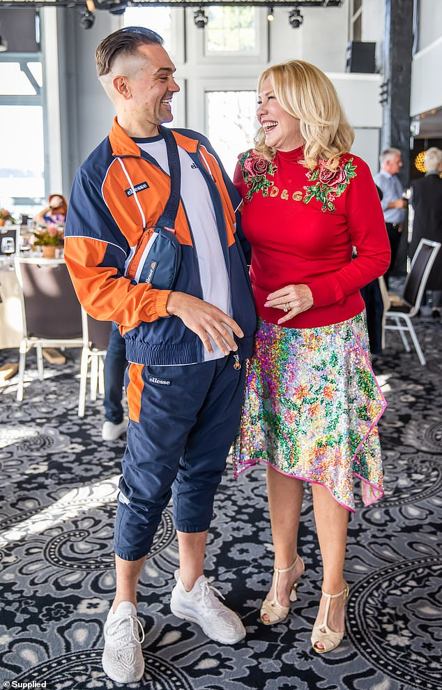 Cheery: The media doyenne was spotted having a laugh with singer-songwriter Mitch Tambo, who opted for a sporty look in an Ellesse tracksuit