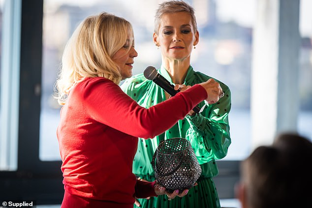 Prizes: Elsewhere at the event, she was seen helping Jessica Rowe announce the winners of a raffle