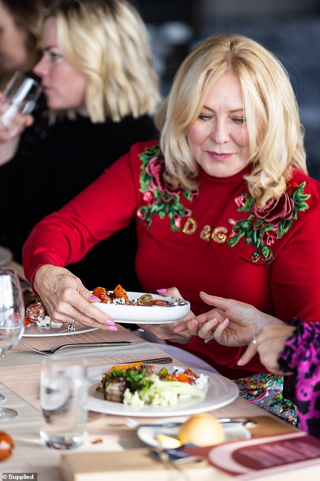 Delicious:Kerri-Anne was later seen enjoying the feast of local produce at the table with fellow guests