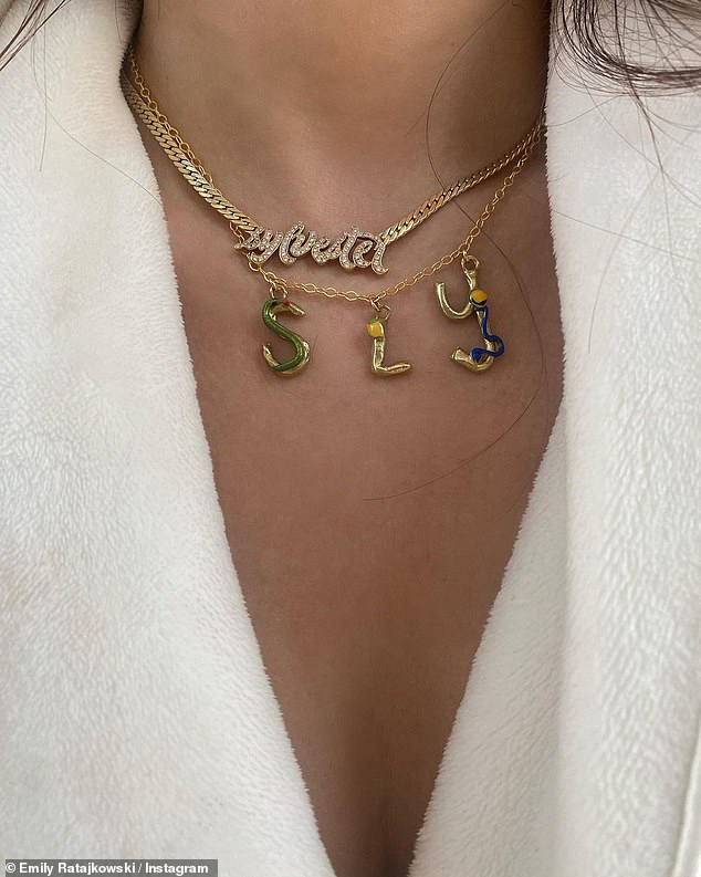 Tribute:Another image showcased the model's gold necklace that featured her son's nickname 'Sly'