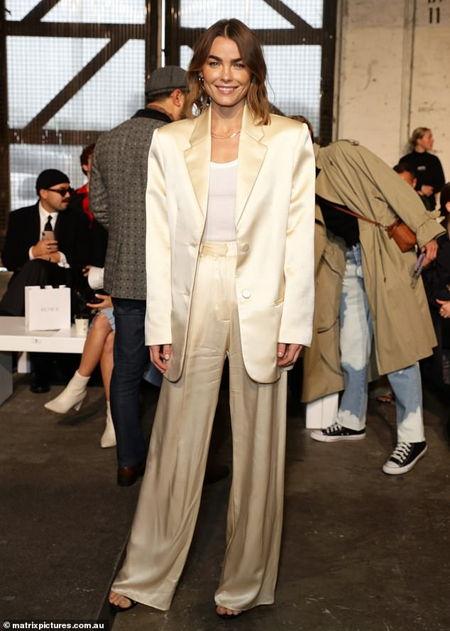 Luscious in lemon: Model Bambi Northwood-Blyth looked incredibly chic in a soft yellow satin suit as she attended the Rumer The Label show at Australian Fashion Week on Thursday
