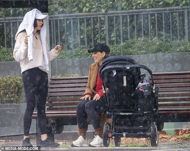 When it rains, it pours! On Thursday, Zoë Foster Blake and Lisa Wipfli got caught in the rain on a walk in Sydney and were forced to take shelter at a bus stop