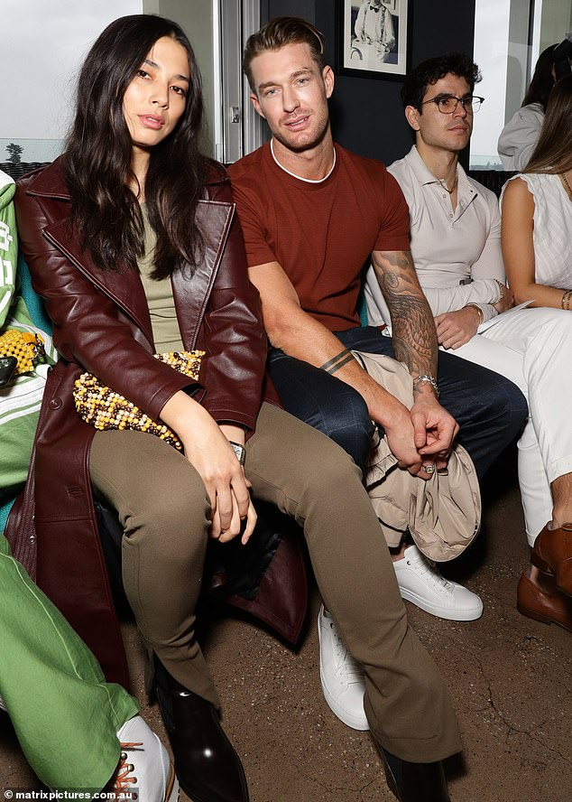 Seeing double! Model Jessica Gomes sat front row at Australian Fashion Week with tattooed Big Brother hunk Chad Hurst in Sydney on Thursday after rumours she's dating the AFL star Dustin Martin