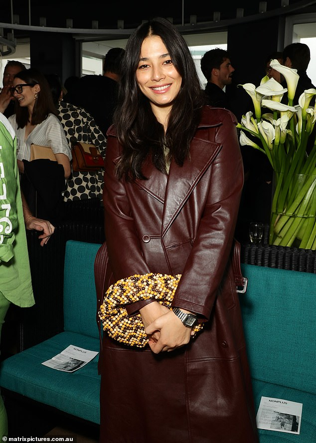 Trendy trench: Jessica looked incredibly chic in abrown leather trench coat