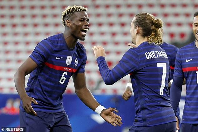 The midfielder celebrates Antoine Griezmann's goal in Wednesday's friendly win over Wales