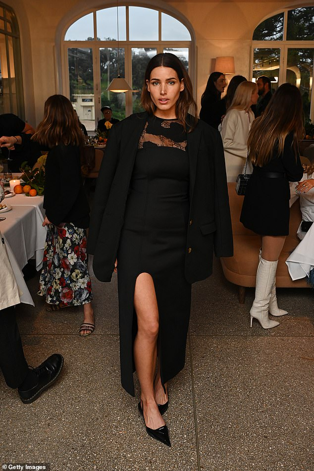 Back in black: Like Jessica, Tahnee also opted for all-black, and wore a figure-hugging long dress with a thigh-high split and lace panel across the chest