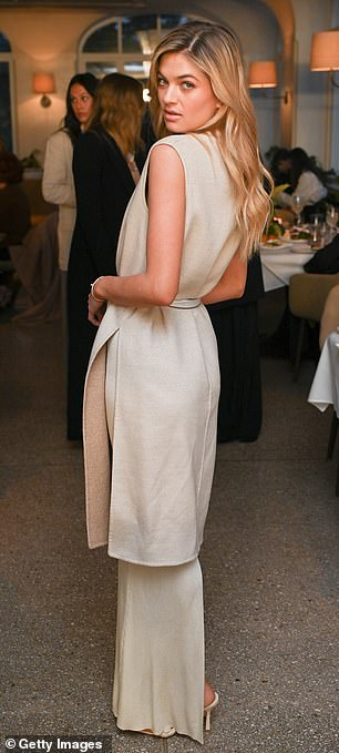 Perfect match: The 29-year-old also donned what appeared to be a matching long vest, which she wore belted at the waist