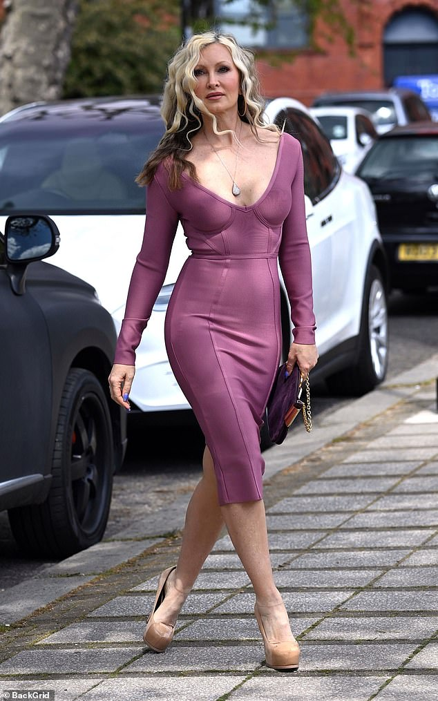 Chic: The American model put on a very leggy display in the figure-hugging dress as she strutted down the street in towering nude stilettos