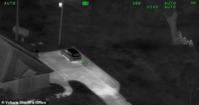 The aerial footage captured officers exchanging gunfire with the children as the girl was shot. The officers can be seen on the far right behind the tree. The children are out of view having fired from the house