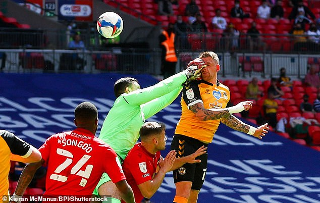 Morecambe goalkeeper Kyle Letheren delivered a double-fisted punch to the side of Scott Bennett's head but no penalty was given