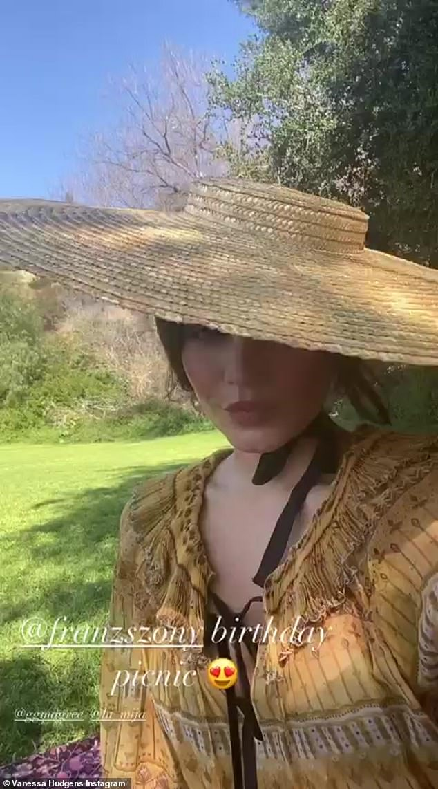 Elegant:Hudgens, posting to her Instagram Story, modeled a wide-brimmed straw hat with an elegant black chin tie for her 41million followers