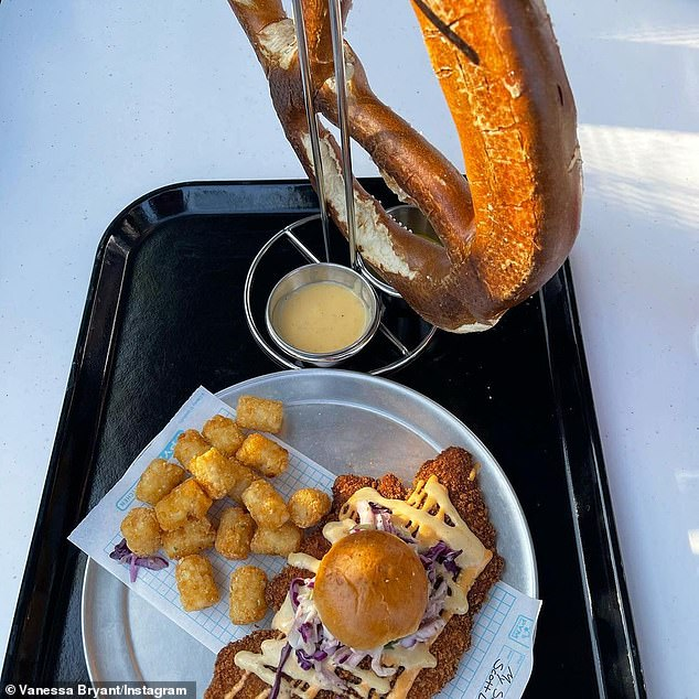 Hungry? At the Pym Test Kitchen, the excited squad indulged in the $15.49 'Not So Little Chicken Sandwich' and $12.99 'Quatnum Pretzel with cheese-beer sauce