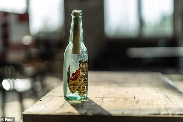 A rolled-up message in a beer bottle (pictured) hidden in the Michigan Central Station in 1913 by two labourers has been discovered by two modern-day construction workers
