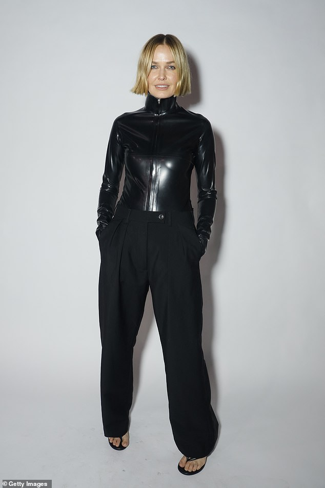 Stylish:Lara Worthington certainly turned heads in an edgy, Matrix-inspired ensemble at Afterpay Australian Fashion Week