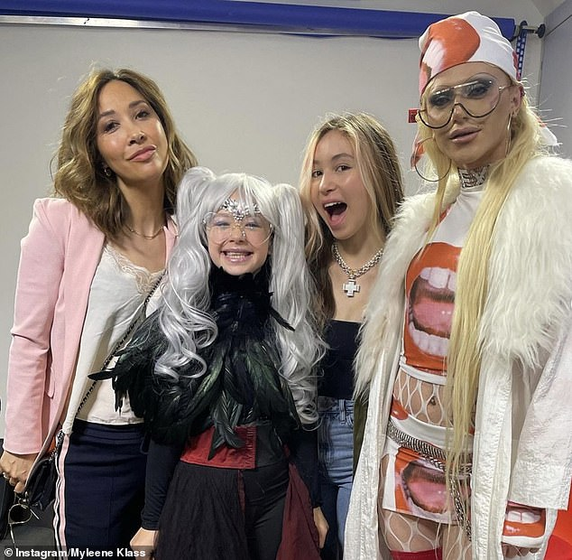 Loving it: Myleene Klass was joined by her daughters, with Hero, 10, dressing up as her drag queen alter-ego in honour of RuPaul's Drag Race UK star Bimini Bon Boulash at Global radio on Friday