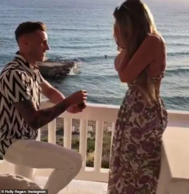 Love story:Jacob proposed during a sunset dinner date at the chic Cotton Beach Club in Ibiza on their second anniversary in June 2019