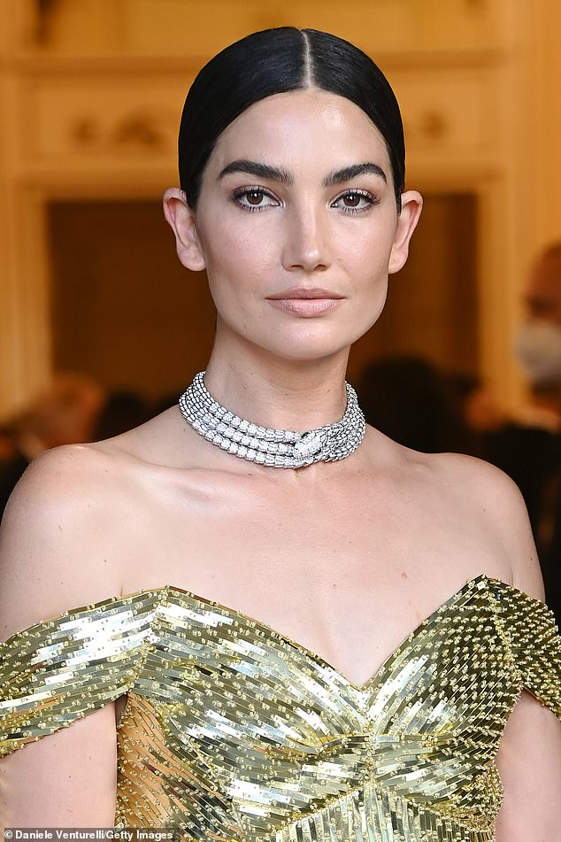 Golden girl: Lily Aldridge stole the show on Thursday as she went to the opera in Italy, clad in a showstopper gold gown
