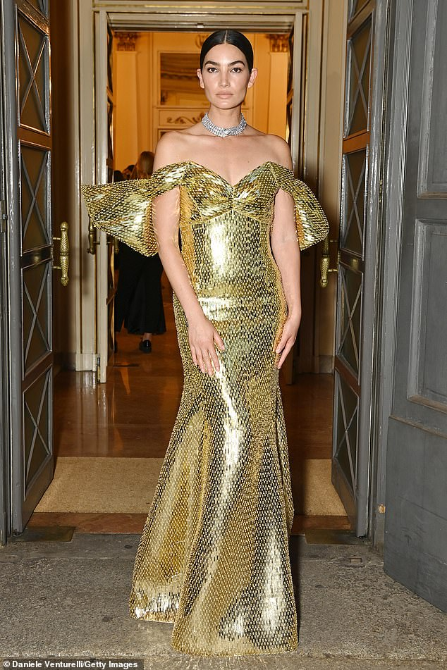 Golden:The Victoria's Secret Angel, 35, worked her best angles at the opulent Teatro Alla Scala theatre in Milan, and uploaded the sensational snaps to Instagram