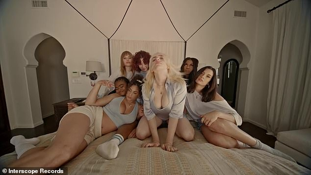 Slumber party! Billie Eilish flashed some major cleavage as she sang in a bed full of her girlfriends in her new music video, Lost Cause