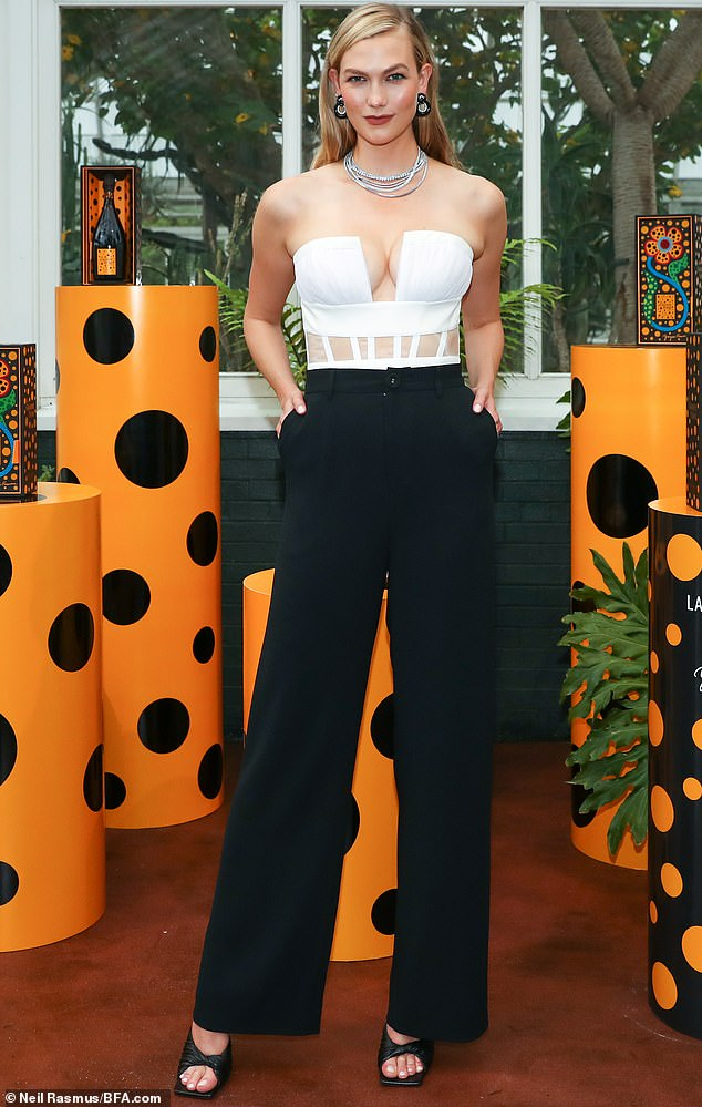Sensation:Karlie Kloss was spotted looking glamorous as ever as she posed up at a star-studded bash at the New York Botanical Garden this week.