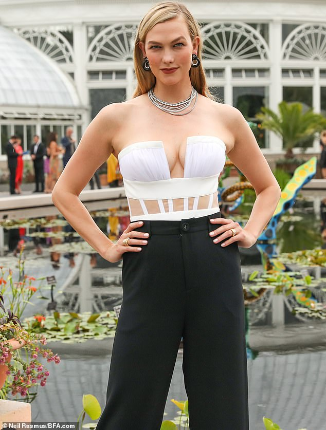 Smoldering:The 28-year-old supermodel made her presence felt at a gala for the botanical gardens - an event that doubled as a Veuve Clicquot cocktail hour