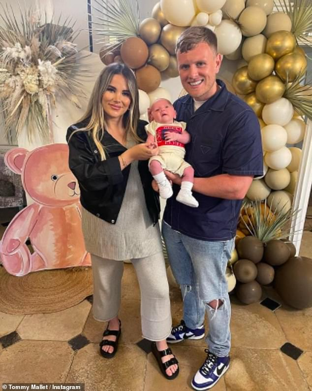 Cute: Georgia Kousoulou and Tommy Mallet looked every inch the proud parents as they shared a sweet snap with their little one Brody on Friday