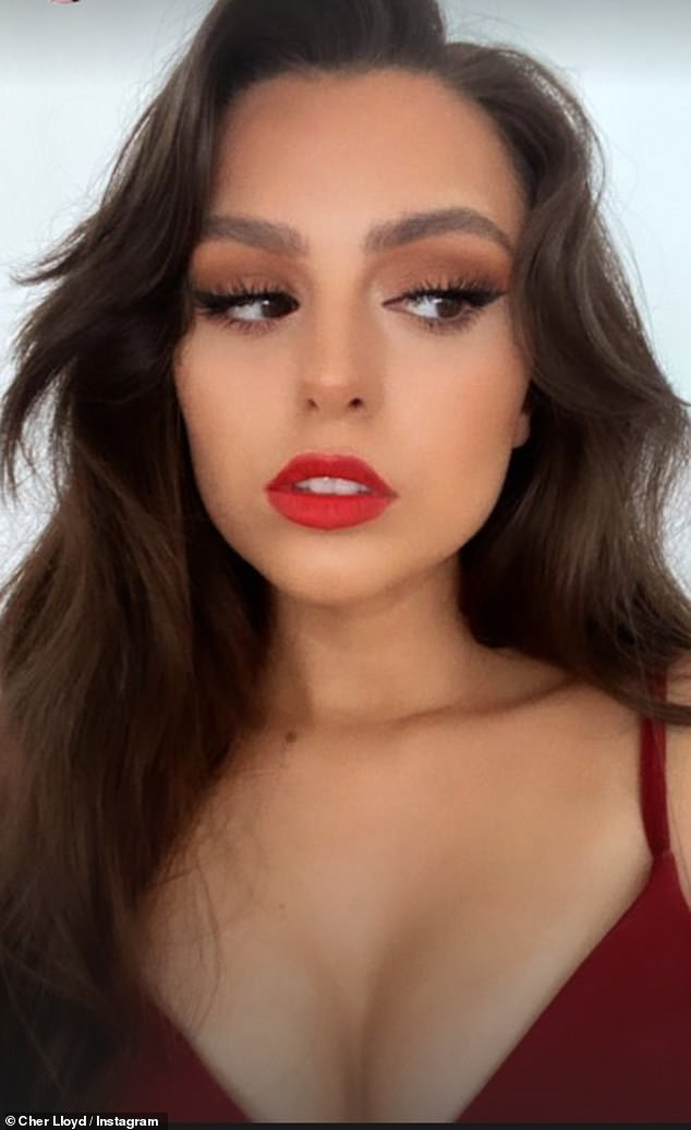 Hair down:Wearing her glossy brunette hair loose, the singer flashed fans a sultry stare, adding the caption: 'With my red dress matching with the lipstick'