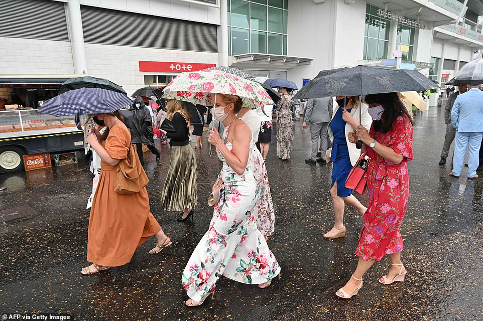 Women in pastel-coloured frocks arrived in their dozens for the event - a mainstay in Britain's racing and social calendar