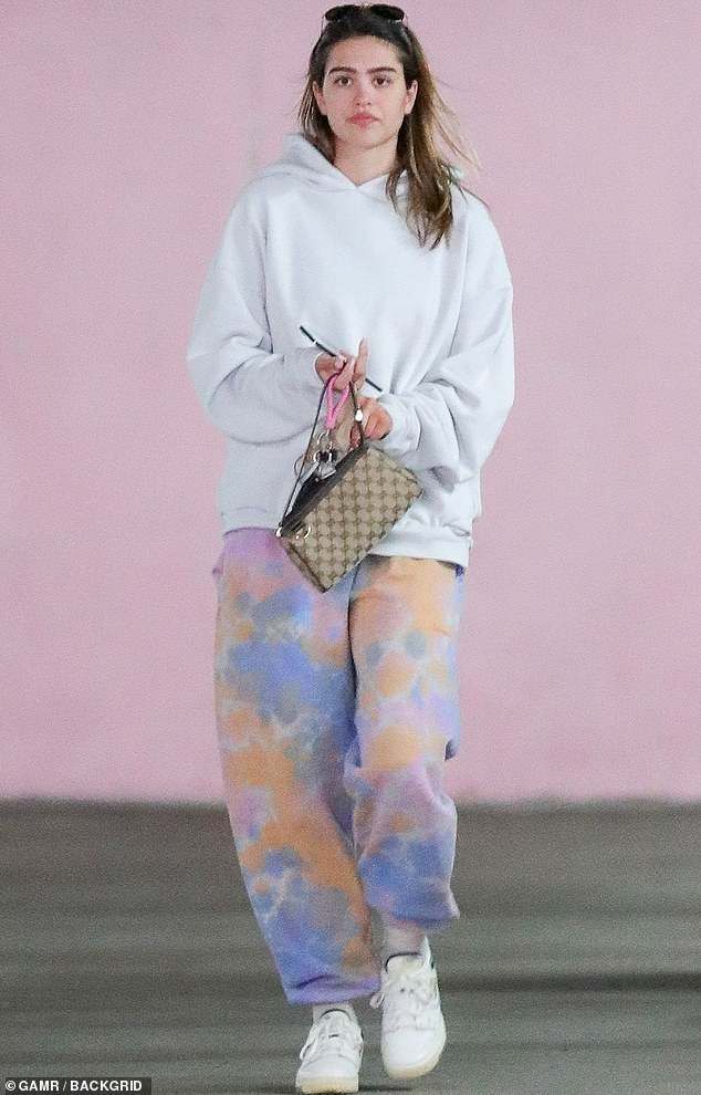 Only the best:The daughter of Lisa Rinna and Harry Hamlin made a splash in an ensemble including tie-dye sweats and a Gucci clutch