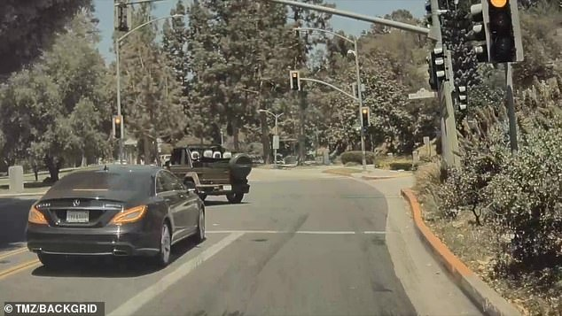 Turning on a red light: He went in the lane besides it and made the left turn around the car