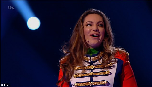 Sneaky:While Kelly revealed the clues about her identity, which included Love Island font on her megaphone - as she presented the first-ever series in 2005 - and references to her cameo on Smallville in 2002 as Victoria Hardwick
