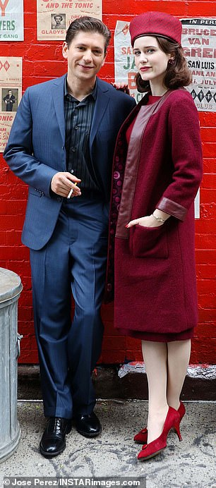 Posed shots: The on-screen couple was seen posing by a brick wall that was decorated with flyers