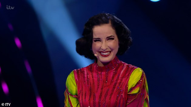 Amazing: Dita Von Teese was unmasked as Beetroot on Monday night's edition of The Masked Dancer and joked she would rather be 'taking her clothes off' on stage