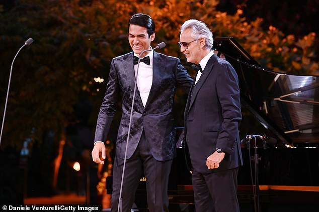Powerful performance: His son Matteo was dressed similarly smartly, also wearing a tuxedo and bow tie, though his jacket was more decorative than his father's