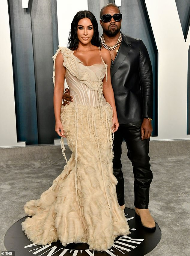 Making the most of it: An insider recently told People that Kim Kardashian was 'doing great' after splitting up from Kanye West; the two are pictured in 2020
