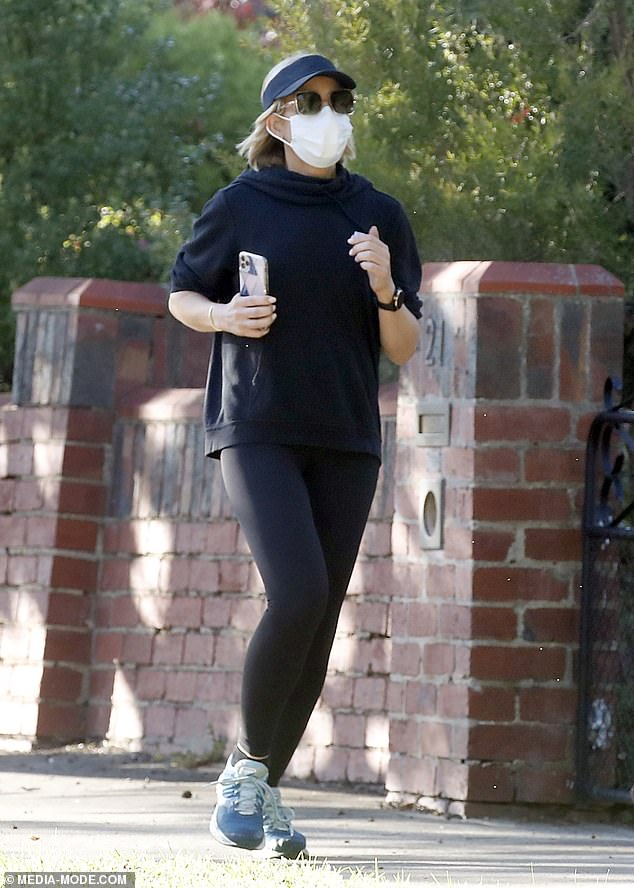 Keeping fit! This week, Carrie Bickmore showed off her trim figure in activewear and wore a face mask as she went for a jog near her home in Melbourne