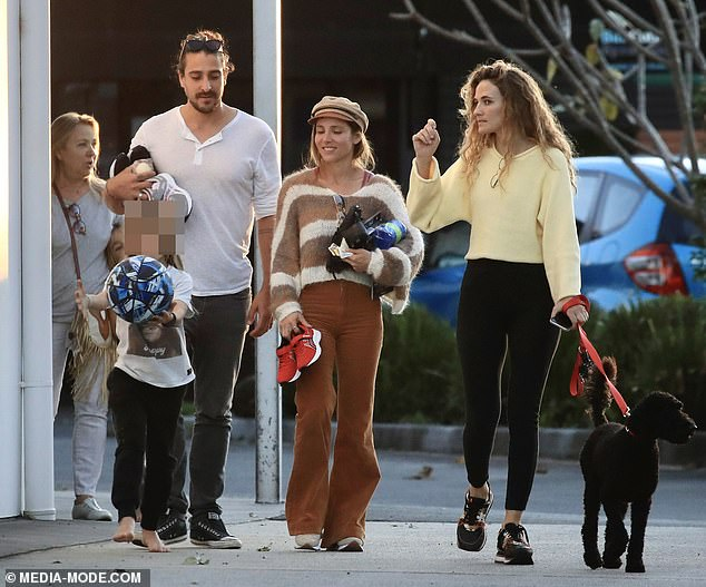Family: Cristian was joined by his nurse wife Silvia Serra (right), the trio appearing cheerful and enjoying the afternoon sunshine