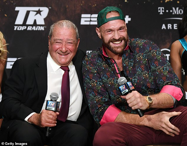 Hearn has accused Arum (left) of 'old school greed' regarding Fury's (right) fight with Wilder