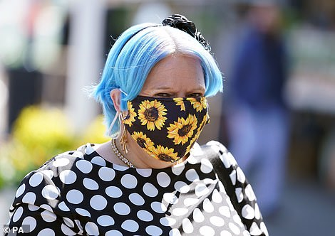 Flowerly fun! One racegoer opted for a bold sunflower print for the sunny day out which she paired with a black and white dress