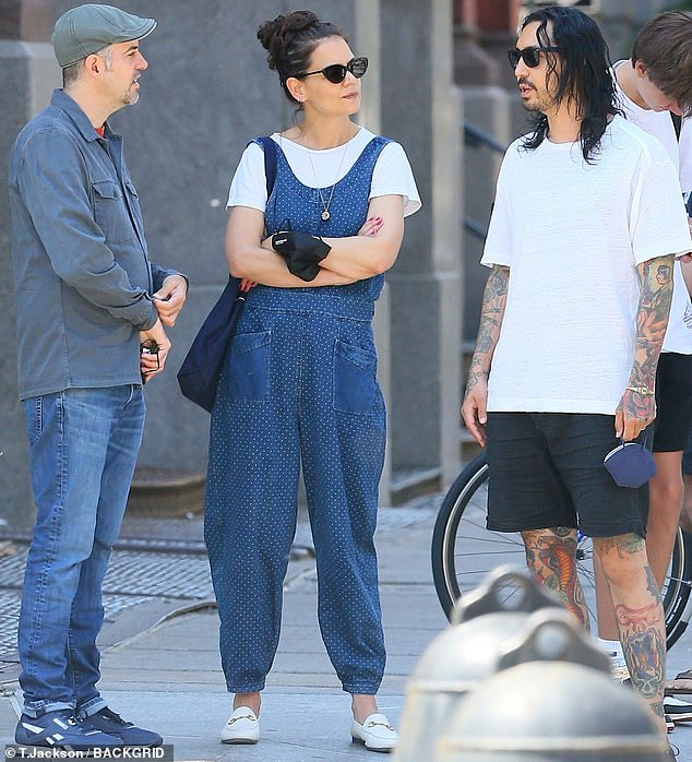 With a little help from her friends:Katie Holmes was spotted enjoying a bit of quality time with a couple of her friends in New York City this Friday