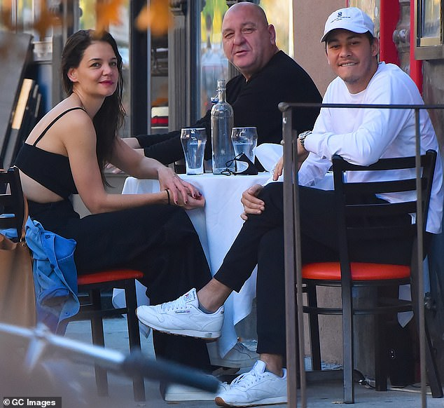 The way they were:Emilio, a chef who runs the restaurant Emilio's Ballato with his father, had been linked to Katie since last September; all three of them are pictured together in November
