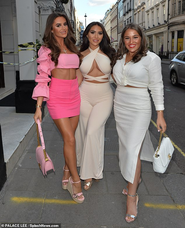 Bronzed:Meanwhile Mia, 26, flashed her toned abs in a peplum sleeve pink crop top and mini skirt as she posed with her pals