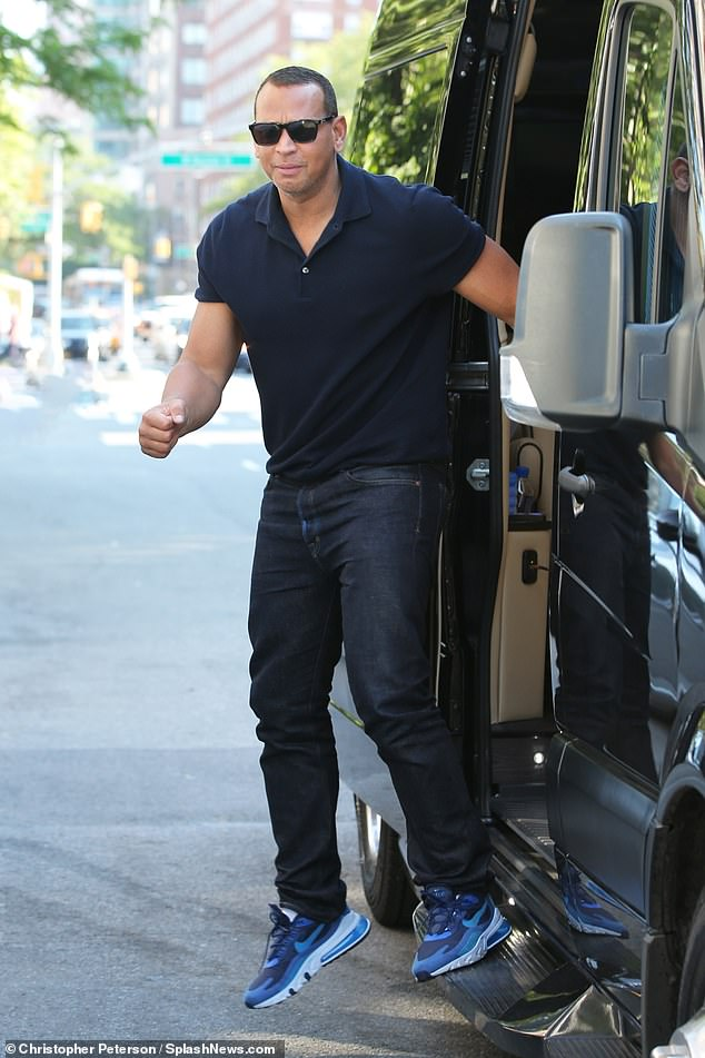 Looking good: He showed off his still-athletic figure in a black polo shirt and matching jeans while wearing sunglasses and a gold luxury wristwatch