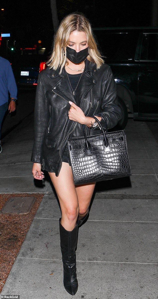 Lady in black: The Pretty Little Liars star, 31, stepped out in an all-black ensemble consisting of a classic leather jacket, knee-high boots and what appeared to be a minidress