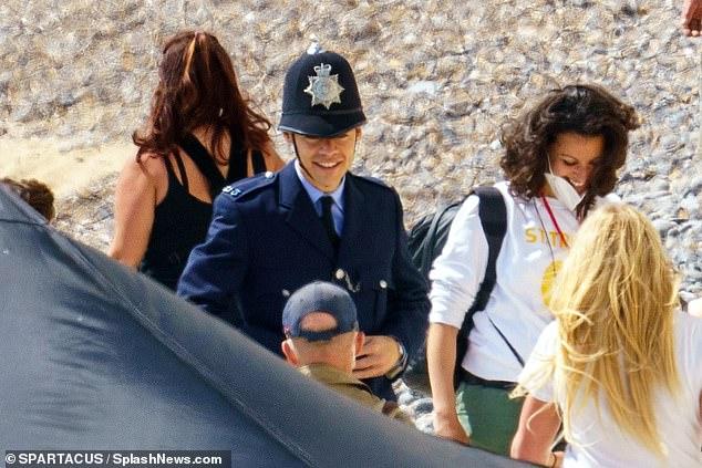 Cheery guy: Harry seemed in good spirits