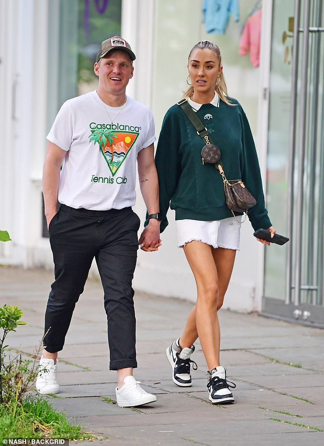 There for each other: Jamie Laing, 32, and Sophie Haboo, 27, were spotted walking hand-in-hand in London on Saturday and appeared loved-up after going public with their romance in 2019